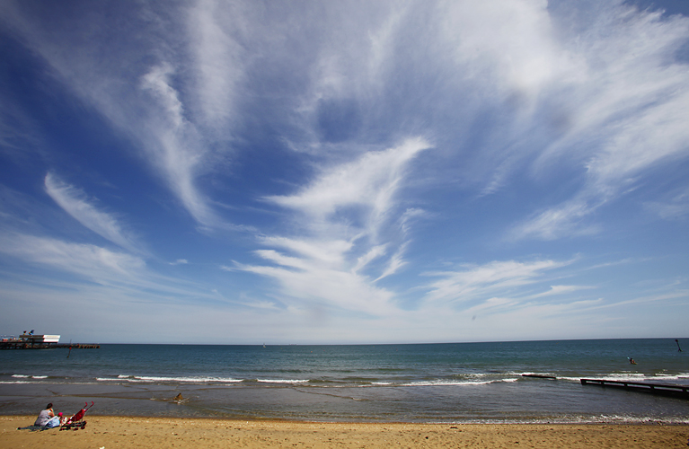 High level clouds over Sandown, Isle of Wight by Adam Gasson