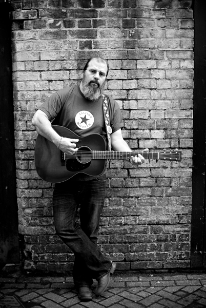 Steve Earle photographed at the Cambridge Corn Exchange for Guitarist by Adam Gasson / threesongsnoflash.net