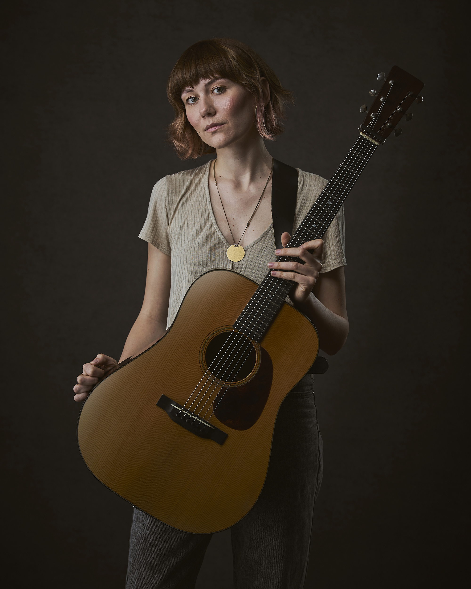Molly Tuttle portrait photograph with an acoustic guitar