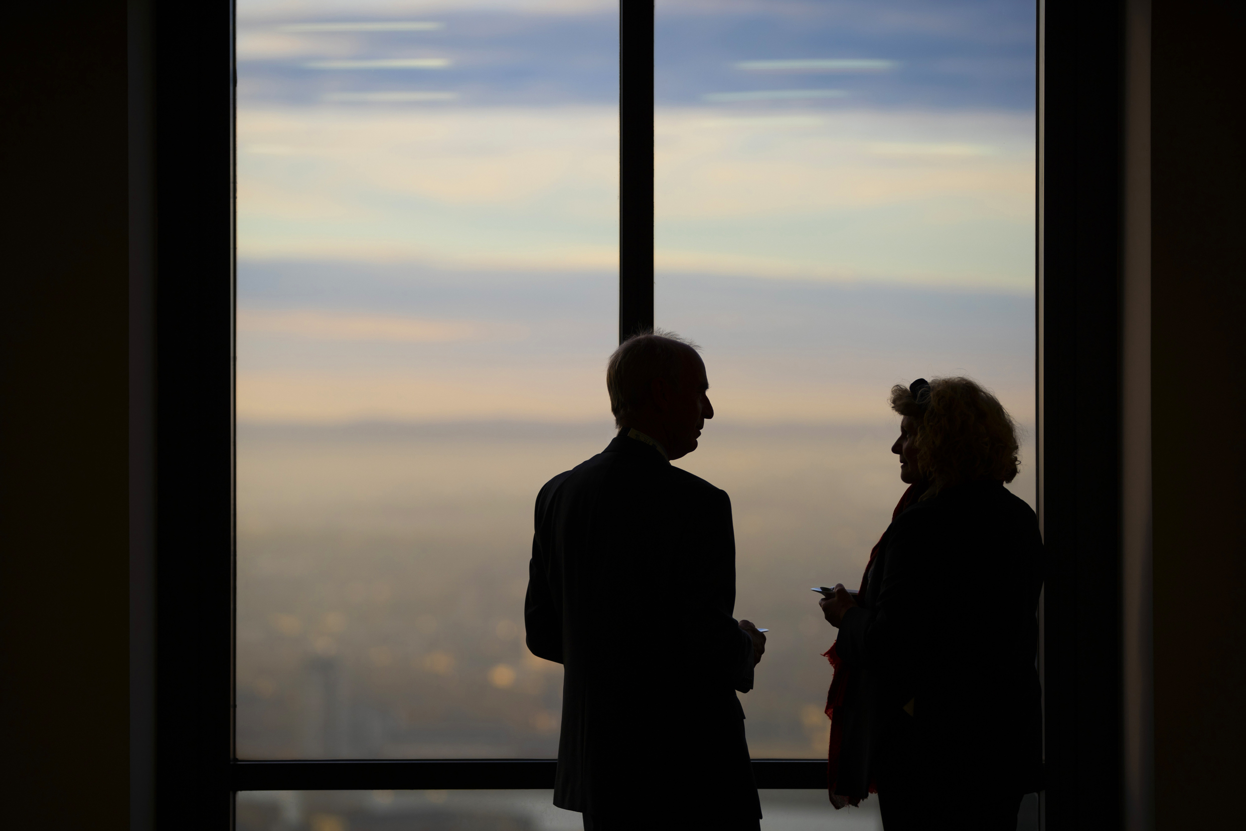Silhouettes of two people at the OBN BioSeed event in London