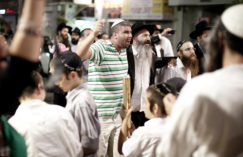 Orthodox Jews in Tel Aviv, Israel by Adam Gasson.