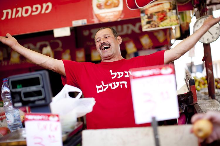 Market seller, Tel Aviv, Israel by Adam Gasson